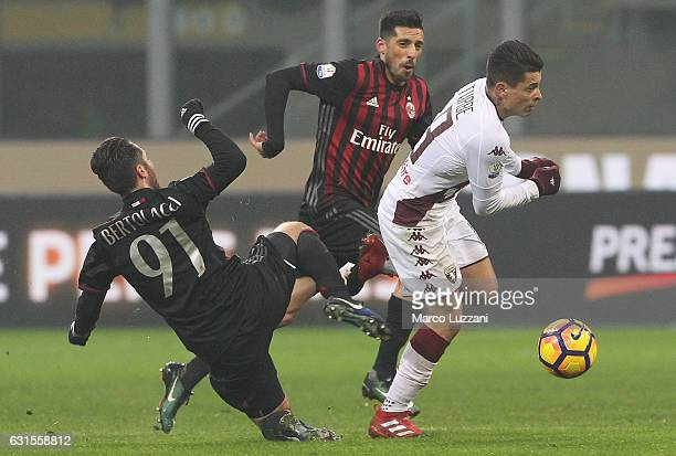 Juan Iturbe of Torino FC is challenged by Andrea Bertolacci of AC Milan during the TIM Cup match between AC Milan and AC Torino at Giuseppe Meazza...