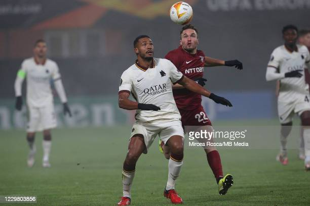 Juan Jesus of AS Roma and Gabriel Debeljuh of CFR Cluj in action during the UEFA Europa League Group A stage match between CFR Cluj and AS Roma at...