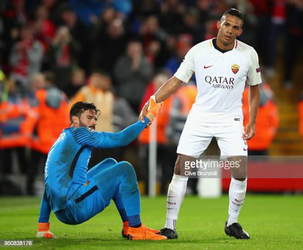 Juan Jesus of AS Roma assists team mates Alisson Becker of AS Roma during the UEFA Champions League Semi Final First Leg match between Liverpool and...