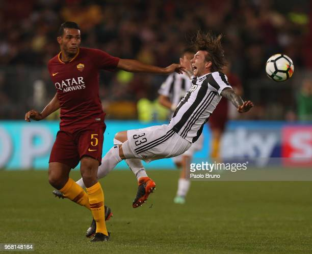 Juan Jesus of AS Roma competes for the ball with Federico Bernardeschi of Juventus during the Serie A match between AS Roma and Juventus at Stadio...