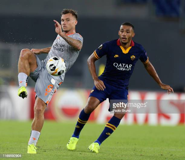 Juan Jesus of AS Roma competes for the ball with Fredrik Gulbrandsen of Istanbul Basaksehir F.K. During the UEFA Europa League group J match between...
