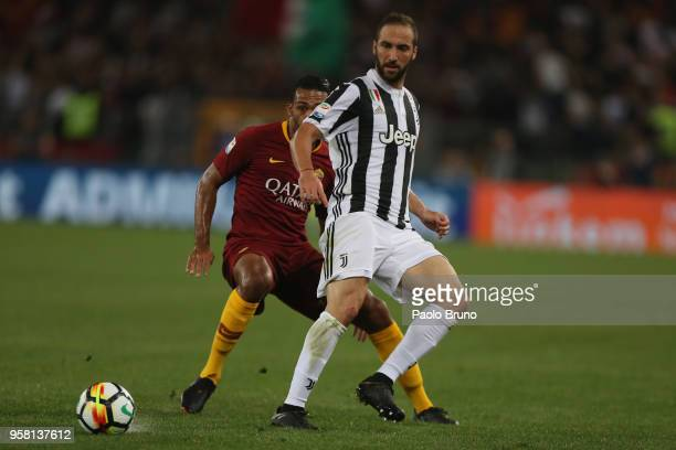 Juan Jesus of AS Roma competes for the ball with Gonzalo Higuain of Juventus during the Serie A match between AS Roma and Juventus at Stadio Olimpico...