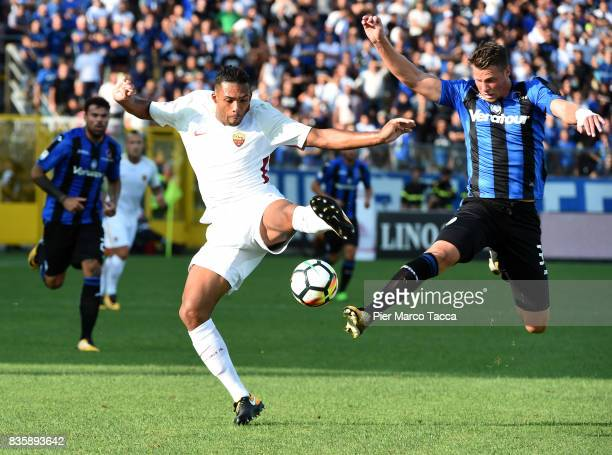 Juan Jesus of AS Roma competes for the ball with Hans Hateboer of Atalanta BC during the Serie A match between Atalanta BC and AS Roma at Stadio...