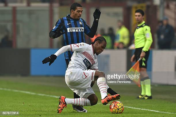 Juan Jesus of FC Internazionale Milano competes with Jerry Mbakogu of Carpi FC during the Serie A match between FC Internazionale Milano and Carpi FC...