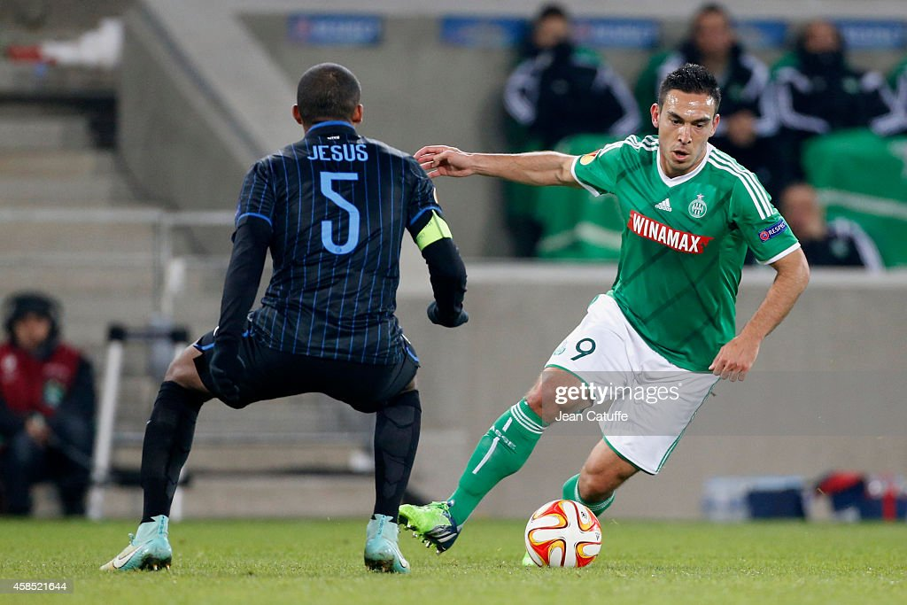 Juan Jesus of Inter Milan (L) and Mevlut Erding of Saint-Etienne in action during the UEFA Europa League Group F match between AS Saint-Etienne and FC Internazionale Milano on November 6, 2014 in Saint-Etienne, France.