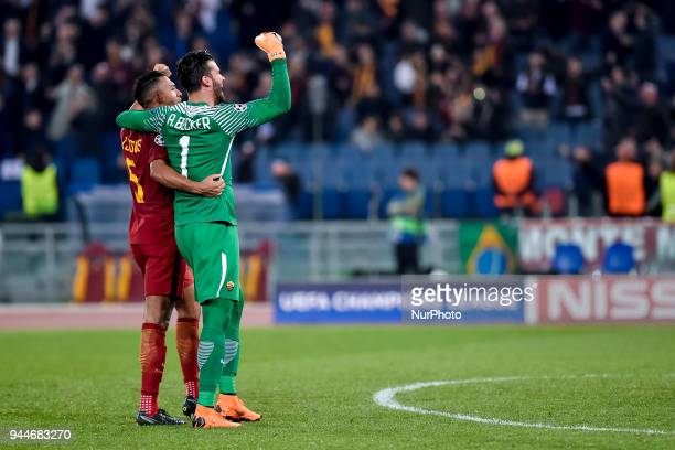 Juan Jesus of Roma celebrates the victory with Allison Becker of Roma after the UEFA Champions League Quarter Final match between Roma and FC...