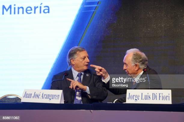 Juan Jose Aranguren Argentina'senergy and mining minister left speaks with Jorge Luis Di Fiori president of Argentina's Chamber of Commerce during...