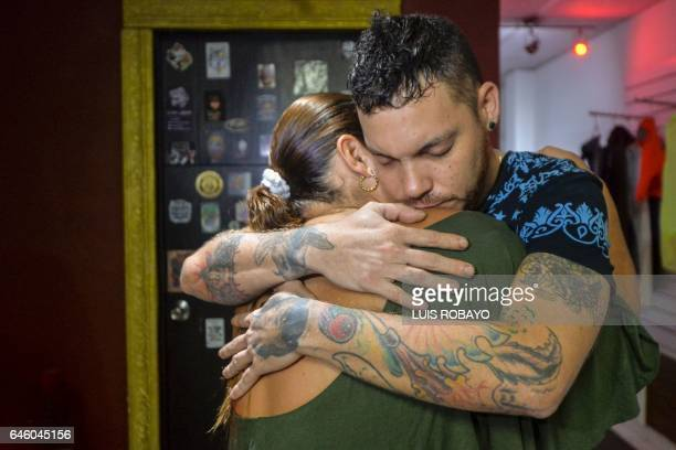 Juan Jose Herrera the son of Ismael Enrique Arciniegas who was arrested in China for drug trafficking hugs a family member on February 27 in Cali...