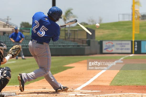 Juan Kelly of the Blue Jays shatters his bat as he hits a fly ball to the pitcher during the Florida State League game between the Dunedin Blue Jays...