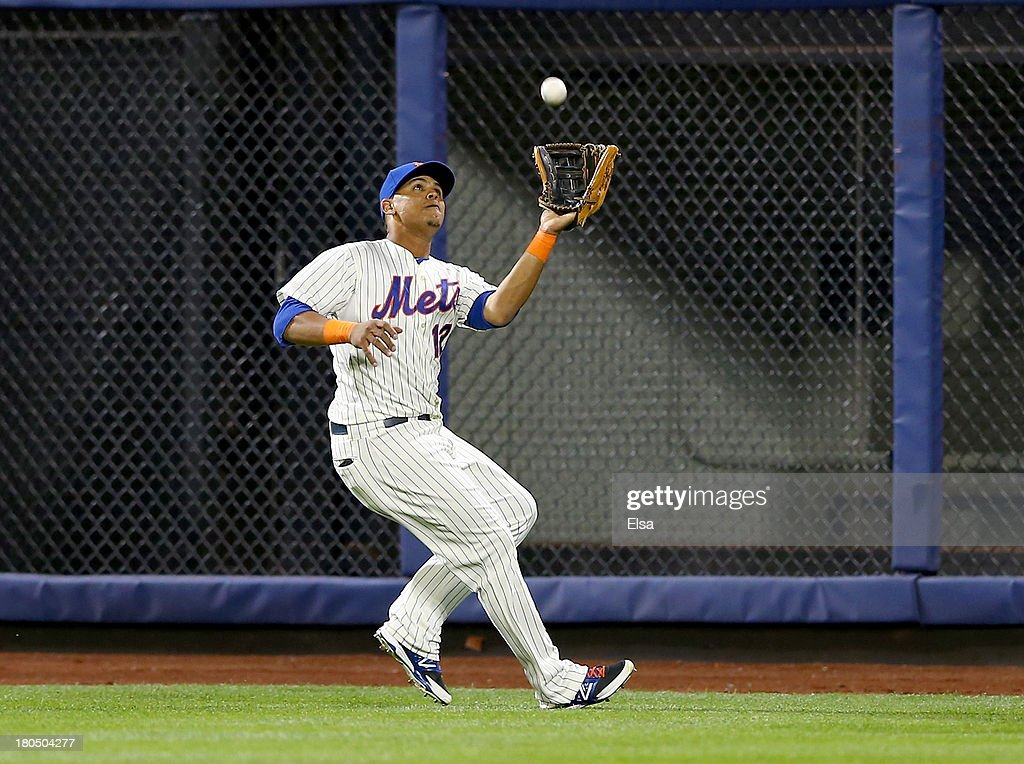 Juan Lagares #12 of the New York Mets catches a hit by Placido Polanco of the Miami Marlins in the eighth inning on August 13, 2013 at Citi Field in the Flushing neighborhood of the Queens borough of New York City. The New York Mets defeated the Miami Marlins 4-3.
