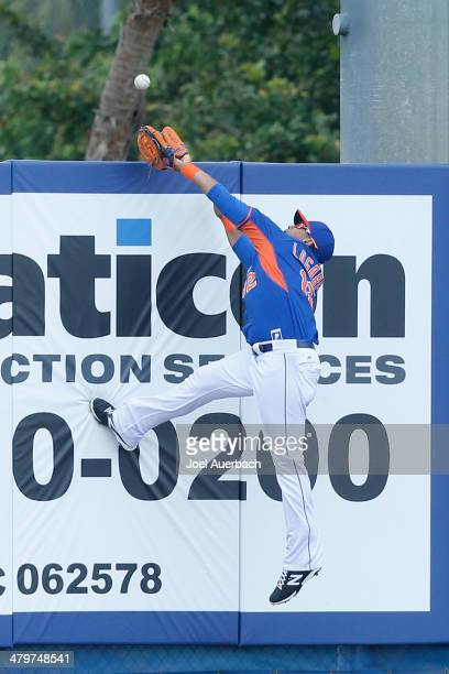 Juan Lagares of the New York Mets catches the ball hit by Justin Upton of the Atlanta Braves in the first inning during a spring training game at...