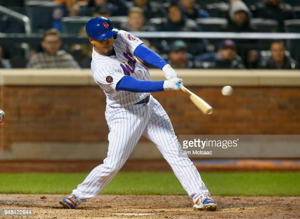 Juan Lagares of the New York Mets connects on an eighth inning two run double against the Washington Nationals at Citi Field on April 18 2018 in the...