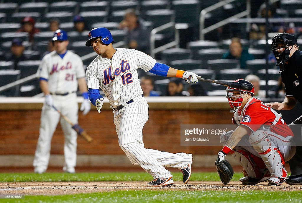 Juan Lagares #12 of the New York Mets follows through on a first inning base hit against the Washington Nationals at Citi Field on September 13, 2014 in the Flushing neighborhood of the Queens borough of New York City.