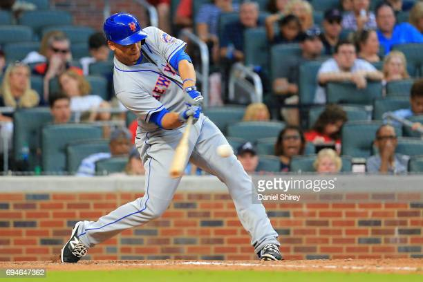 Juan Lagares of the New York Mets hits a twoRBI double during the ninth inning against the Atlanta Braves at SunTrust Park on June 10 2017 in Atlanta...