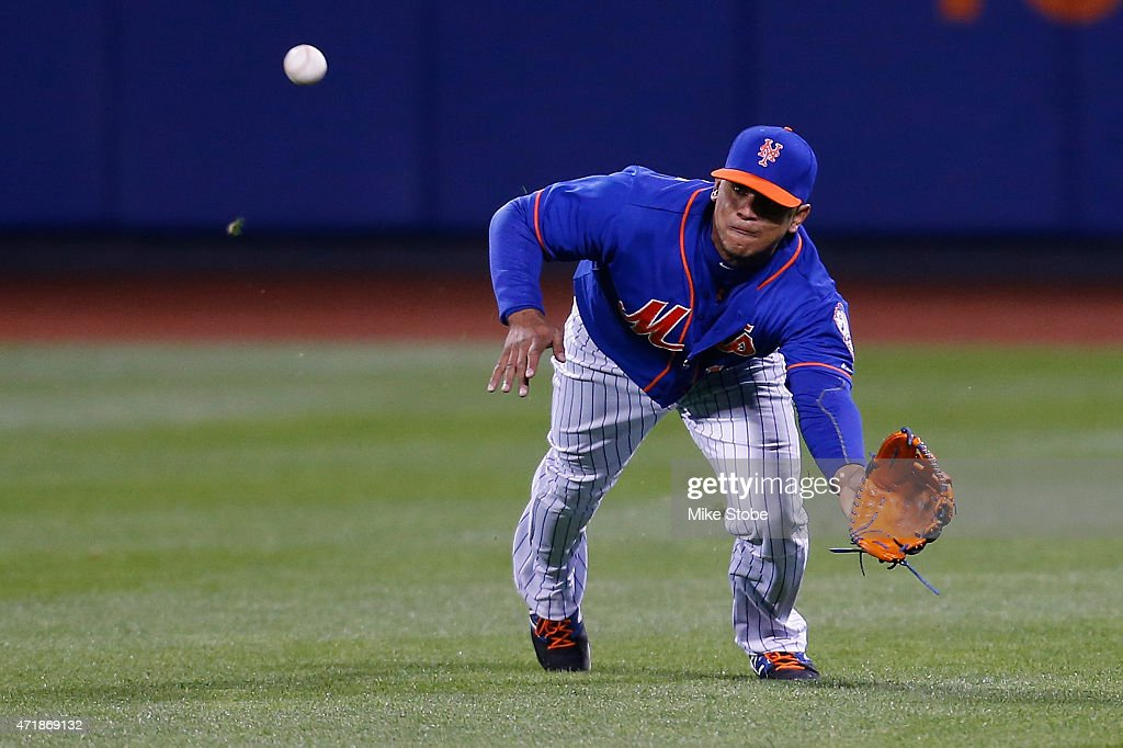 Juan Lagares #12 of the New York Mets makes a diving catch against the Washington Nationals in the fifth inning at Citi Field on May 1, 2015 in the Flushing neighborhood of the Queens borough of New York City.