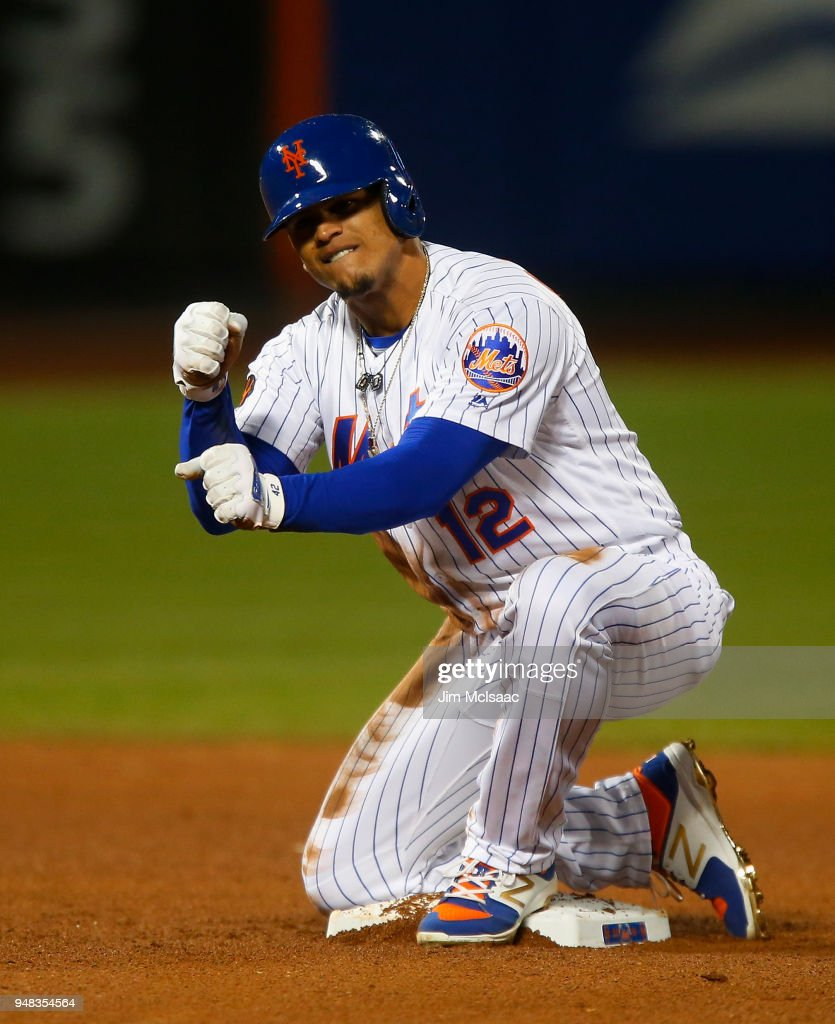 Juan Lagares #12 of the New York Mets reacts after his eighth inning two run double against the Washington Nationals at Citi Field on April 18, 2018 in the Flushing neighborhood of the Queens borough of New York City.