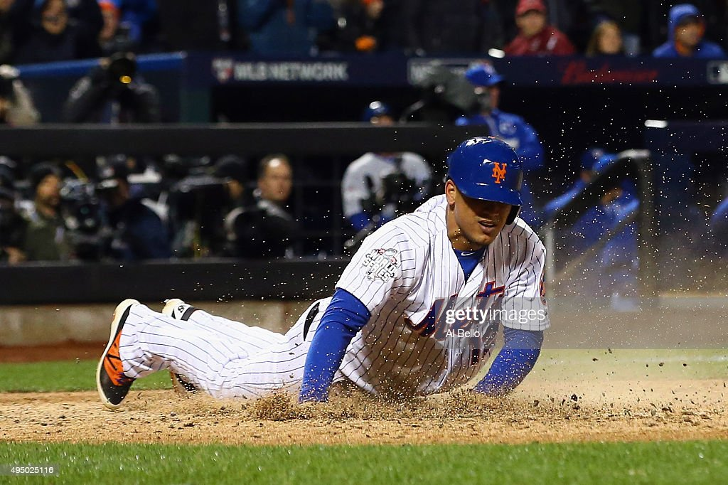 Juan Lagares #12 of the New York Mets scores in the sixth inning against the Kansas City Royals during Game Three of the 2015 World Series at Citi Field on October 30, 2015 in the Flushing neighborhood of the Queens borough of New York City.