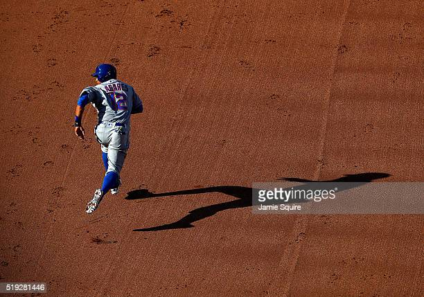 Juan Lagares of the New York Mets sprints toward second base during the 7th inning of the game against the Kansas City Royals at Kauffman Stadium on...
