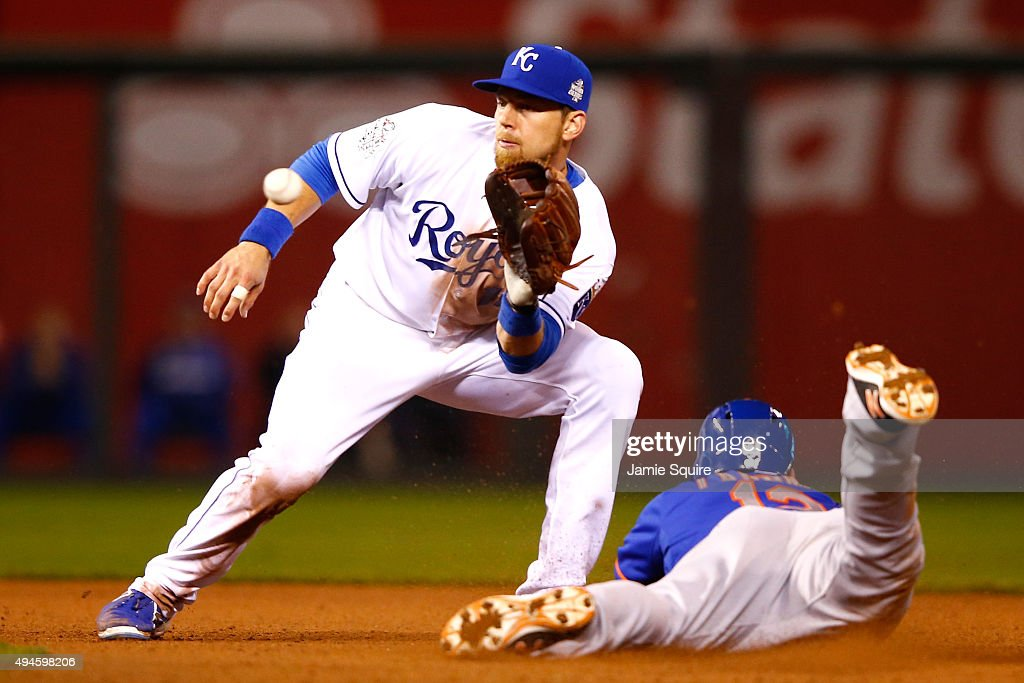 Juan Lagares #12 of the New York Mets steals second base as Ben Zobrist #18 of the Kansas City Royals covers in the eighth inning during Game One of the 2015 World Series at Kauffman Stadium on October 27, 2015 in Kansas City, Missouri.