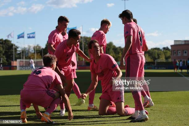 Juan Latasa of Real Madrid celebrates with teammates after scoring the 1-0 lead during the UEFA Youth League Semi Final match between Salzburg and...