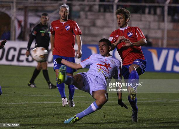 Juan Lojas of Real Garcilaso fights for the ball with Ivan Alonso of Nacional during the match between Real Garcilaso of Peru and Nacional of Uruguay...