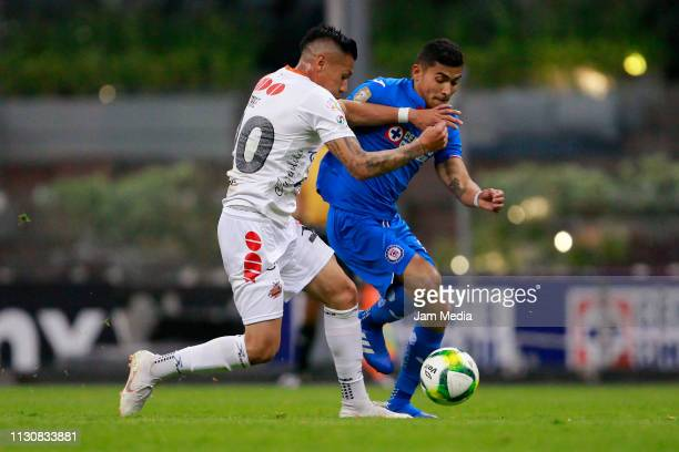 Juan Lopez of Alebrijes fights for the ball with Orbelin Pineda of Cruz Azul during a match between Cruz Azul and Alebrijes as part of the Copa MX...