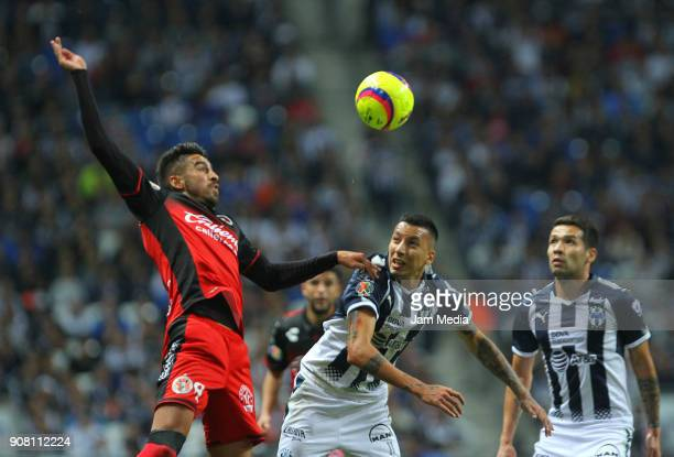 Juan Lucero of Tijuana and Leonel Vangioni of Monterrey fight for the ball during the third round match between Monterrey and Tijuana as part of...