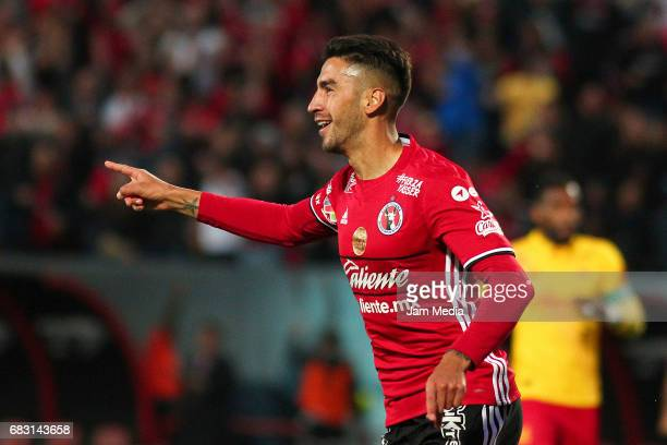 Juan Lucero of Tijuana celebrates after scoring his team's second goal during the quarter finals second leg match between Tijuana and Morelia as part...