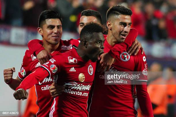 Juan Lucero of Tijuana celebrates with teammates after scoring his team's second goal during the quarter finals second leg match between Tijuana and...