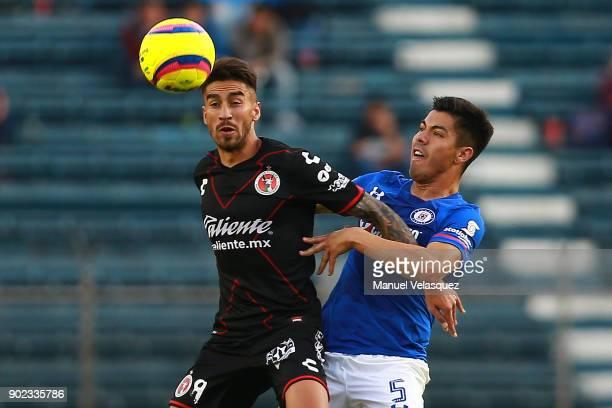 Juan Lucero of Tijuana struggles for the ball against Francisco Silva of Cruz Azul during the first round match between Cruz Azul and Tijuana as part...