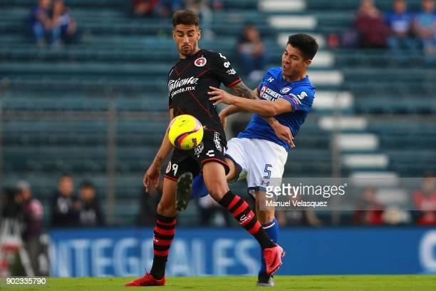 Juan Lucero of Tijuana struggles for the ball with Francisco Silva of Cruz Azul during the first round match between Cruz Azul and Tijuana as part of...