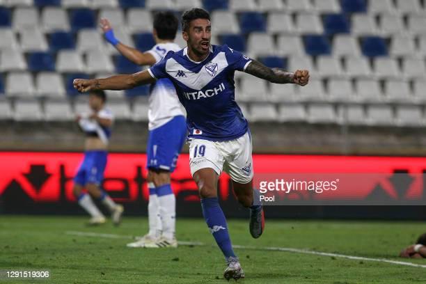 Juan Lucero of Velez celebrates after scoring the third goal of his team during a quarter final second leg match between Universidad Católica and...