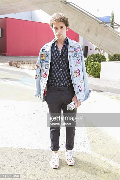 Juan Luis Vias wears Converse shoes Zara pants Mango Shirt and Diy Jacket during Mercedes Benz Fashion Week at Ifema on February 19 2016 in Madrid...