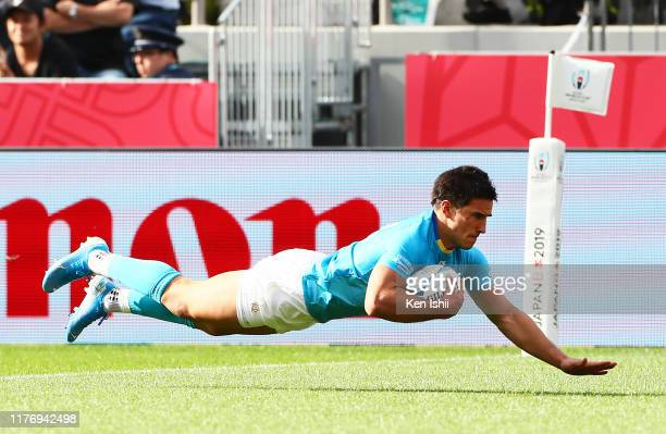 Juan Manuel Cat of Uruguay dives to score his side's third try during the Rugby World Cup 2019 Group D game between Fiji and Uruguay at Kamaishi...