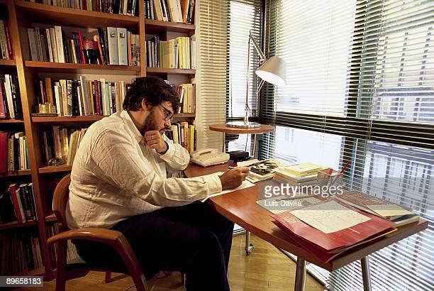 Juan Manuel de Prada writer The writer in their work table in their house