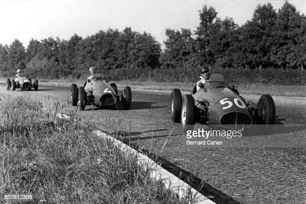 Juan Manuel Fangio, Alberto Ascari, Nino Farina, Maserati A6GCM, Grand Prix of Italy, Monza, 13 September 1953. Through the cobblestone pavement of...