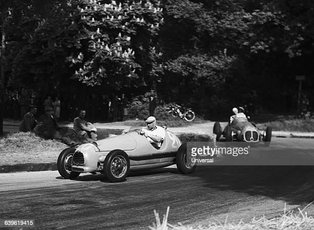 Juan Manuel Fangio and Giuseppe Nino Farina during the Paris Formula One Grand Prix in the Bois de Boulogne.