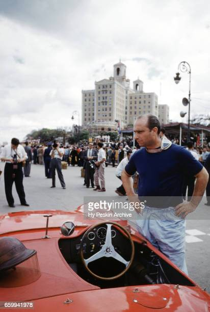 Juan Manuel Fangio driver of the Maserati 300S stands next to his car before the start of the 1957 Cuban Grand Prix on February 24 1957 in Havana Cuba