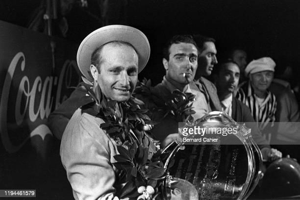 Juan Manuel Fangio, Eugenio Castellotti, Luigi Musso, Sebring 12 Hours, Sebring, 24 March 1956. Juan Manuel Fangioafter his victory in the 1956...