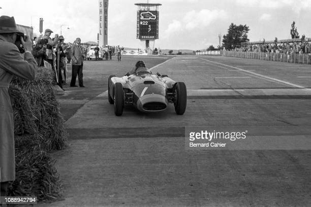 Juan Manuel Fangio, Ferrari D50, Grand Prix of Germany, Nurburgring, 05 August 1956. Juan Manuel Fangio at the wheel of his Ferrari D50 coming back...