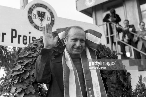 Juan Manuel Fangio, Grand Prix of Germany, Nurburgring, 05 August 1956. Juan Manuel Fangio on the podium waving after his victory in the 1956 German...