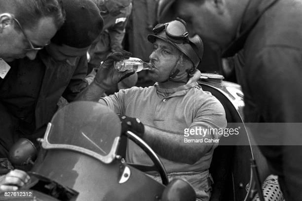 Juan Manuel Fangio, Maserati A6GCM, Grand Prix of Great Britain, Silverstone, 18 July 1953. Drinking.