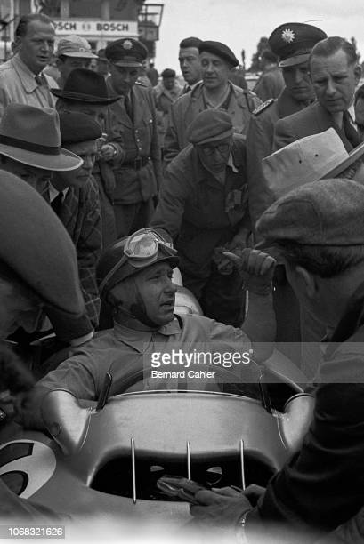 Juan Manuel Fangio, Mercedes W196, Grand Prix of Germany, Nurburgring, 01 August 1954. Juan Manuel Fangio sitting in his W196 Mercedes Grand Prix car...