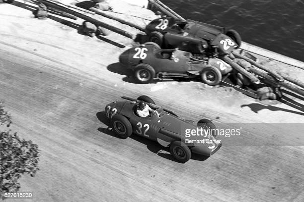Juan Manuel Fangio Peter Collins Mike Hawthorn Maserati 250F Ferrari 801 Grand Prix of Monaco Monaco 19 May 1957 Juan Manuel Fangio goes by the two...