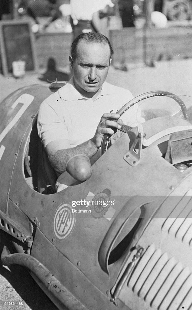 Juan Manuel Fangio Sitting in Race Car : ニュース写真
