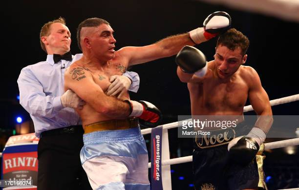 Juan Manuel Garay of Argentina exchange punches with Noel Gevor of Germany during their cruiserweight fight at Max Schmeling Halle on June 8 2013 in...