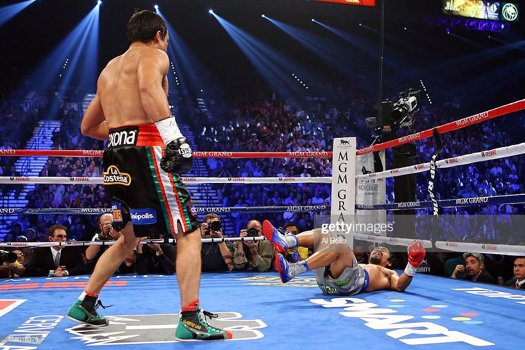 Juan Manuel Marquez knocks down Manny Pacquiao in the third round during their welterweight bout at the MGM Grand Garden Arena on December 8, 2012 in Las Vegas, Nevada.