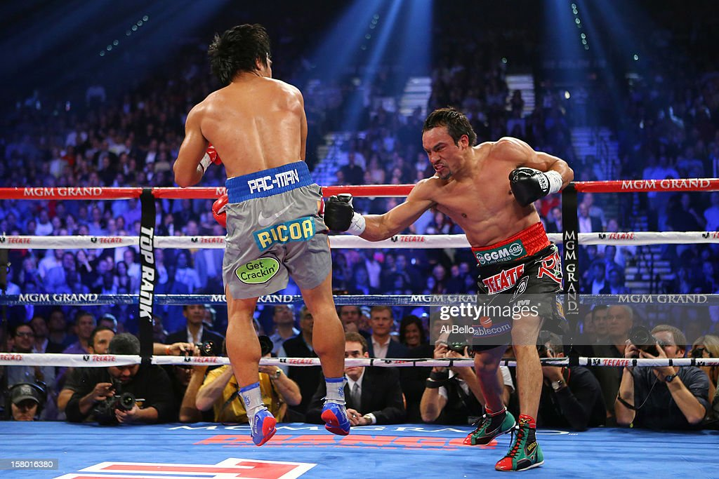 Juan Manuel Marquez throws a right at Manny Pacquiao during their welterweight bout at the MGM Grand Garden Arena on December 8, 2012 in Las Vegas, Nevada.
