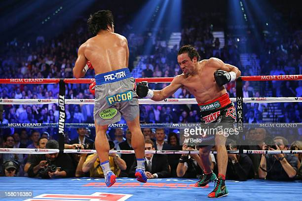 Juan Manuel Marquez throws a right at Manny Pacquiao during their welterweight bout at the MGM Grand Garden Arena on December 8 2012 in Las Vegas...