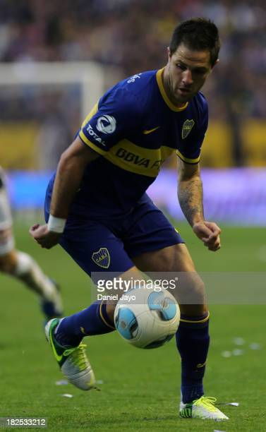 Juan Manuel Martinez, of Boca Juniors in action during a match between Boca Juniors and Quilmes as part of the Torneo Inicial 2013 at Alberto J...
